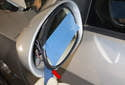 Mirror glass: Using a plastic prying tool (red arrow), gently lever out the mirror glass.