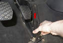 Push the pedal assembly up (red arrow) to detach it from the floor of the vehicle.