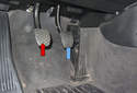 The brake light switch (blue arrow) is mounted in front of the brake pedal and the clutch switch is mounted to the clutch master cylinder (red arrow).