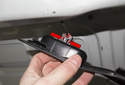 Pull the handle trim panel down, then squeeze the cable locking tabs (red arrows) and pull the cable out of the trim.