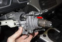 Once free, slide the steering column lock and steering stub shaft out of the steering column (red arrow).
