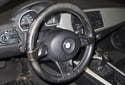 The BMW Z4 steering wheel and steering column house a number of electrical and electronic controls.