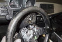Lift the steering wheel off the steering column shaft.
