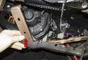 Remove the instrument panel support (red arrow) from the instrument panel.