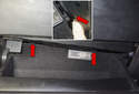 Then press the tabs up (red arrows) as you pull the glove box down to extend it.