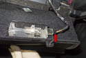 Next, disconnect the glove box light electrical connector (red arrow).
