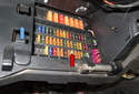 Once removed, you have access to the interior fuse panel (red arrow).