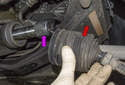 Slide the dust boot (red arrow) toward the outer tie rod end.