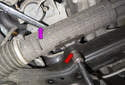 For the right side fastener, you can fit an open end wrench (purple arrow) through the opening at the top while removing the bolt (red arrow).