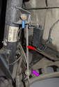 Front: The front sway bar link (red arrow) connects the strut (blue arrow) to the sway bar (purple arrow).
