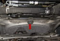 Front: When using a hydraulic floor jack to lift the front of the vehicle, place the hydraulic floor jack under the round subframe support (red arrow).