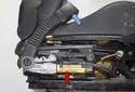 First you have to remove the seat that requires the new pretensioner (red arrow) and seat belt buckle (blue arrow).