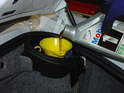 Fill your car with oil from the inlet in the front of the rear trunk.