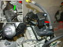 The Carrera 996 engine has an electrical junction box (red arrow) that needs to be moved to the standard location on the Boxster (near the power steering pump, see next photo).