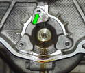 The holes that hold on the intermediate shaft cover are through-holes, which means they exit out into the engine case.