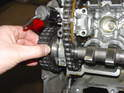 Now, loosen up the chain tensioner on the head (refer to Photo 16 for cylinders 1-3 or photo 17 for cylinders 4-6).
