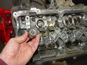 With the camshafts removed, you can simply pluck out the lifters (tappets).