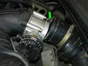 Disconnect the two clamps (one at each end) that hold the stock air intake tube to the throttle body (green arrow).