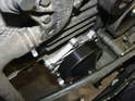 The water pump is located next to the crankshaft on the right side of the car.