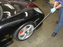 With the car back on the ground, use a really big torque wrench to tighten up the axle nut.