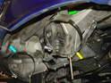 The system utilizes the long, stock muffler mounting bracket that normally attached to the top of the stock muffler.