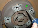 There are two small locator screws that hold the brake disc in place.