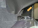 The top is attached to a plastic channel piece that runs down the center of the car.