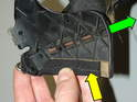 With the rivets detached from the frame, the slider piece can be removed from the top by peeling back the top material (yellow arrow) and sliding its groove out of the plastic retainer that is sewn into the top liner (green arrow).