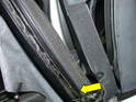 The yellow arrow points to the locking strip that holds the roof fabric to the channel.