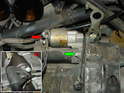 This photo shows the starter and one of the two bolts that hold it to the engine case.