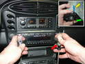 In order to plug in the rear speaker connection, you need to remove your radio.