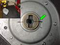 With the transmission removed from the car use a drill (inset picture) connected to the cable to turn the transmission to the closed mark (green arrow).