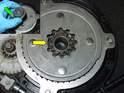 Remove the center gear (inset picture green arrow), and note the position of the indexing notch (yellow arrow), which indexes the center gear to the micro switch cam.