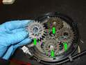 Remove the four planetary gears (green arrows).