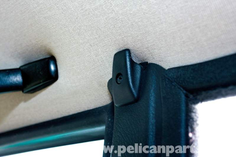 Hidden behind this hook is one of the screws you need to remove to gain access to the rear side-window trim