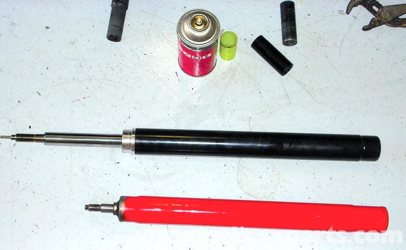 This is what the factory and AST strut inserts look like. The factory one is red and does not have gas-charged internals