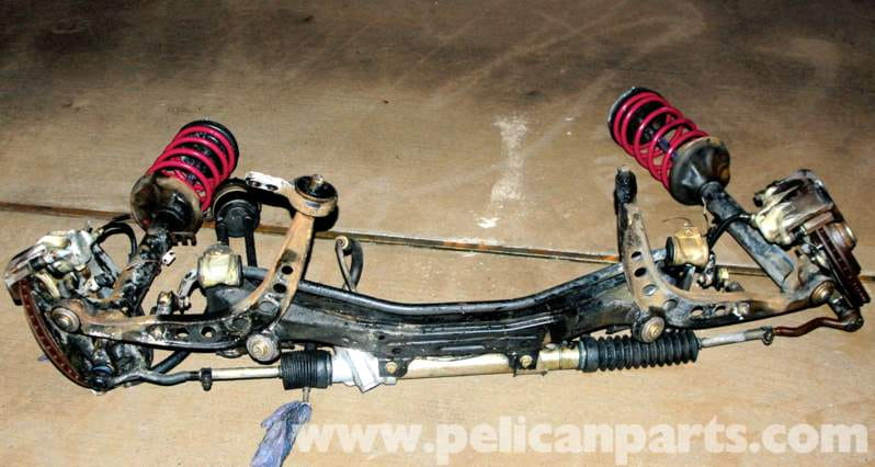Here''s an E30 front suspension out of the car