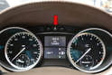 With the mileage showing use your finger tip and press the R button in the top center of the dash (red arrow) three times.