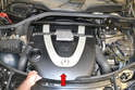To remove the front cover simply grasp it at the front and lift it straight up (red arrow).