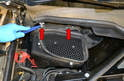 Unclip the two clips on the air box on the right rear of the engine bay (red arrows).