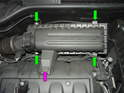 (Mk2 MINI Cooper) Shown here are the four screws (green arrows) and the 10mm bolt (purple arrow) that hold down the air filter cover on the Mk2 MINI Cooper.