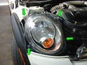 Begin removing the belt on the R55/56/57 MINI by removing the left front headlight.