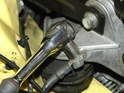 Remove the ground strap from the engine mount bracket on the passenger side of the car.