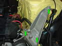 Now remove the three 16mm bolts holding the upper mount arm to the chassis (green arrows).