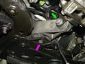 The green arrow and the purple arrow are the two bolts that secure the lower engine mount to both the engine and the front subframe.