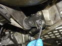 Now remove the four 13mm bolts holding the mounting bracket to the side of the engine.