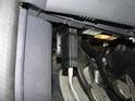 The OBD port is located near the driver's foot well, on the lower left side.