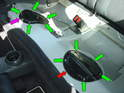 Shown here are the two plates that allow access both the fuel pump (red arrow) and also the fuel filter (purple arrow) mounted in the fuel tank.