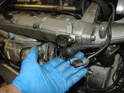Disconnect the electrical connector to the T-MAP sensor on the front of the intake manifold and also disconnect the electrical connection that was attached to the bracket you removed in the last step.