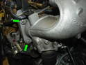 Now remove the two 13mm nuts on the intercooler output air duct as shown here (green arrows).